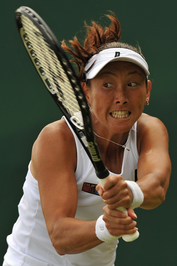 Japan's Ai Sugiyama returns a ball to Spain's Arantxa Parra Santonja during their second round match in the 2009 Wimbledon tennis championships at the All England Club on June 24, 2009. The event, the third Grand Slam tournament of 2009, runs from June 22  to  July  5, 2009. AFP PHOTO / CARL DE SOUZA (Photo credit should read CARL DE SOUZA/AFP/Getty Images)